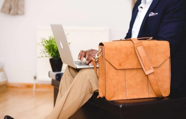 Man at laptop with briefcase