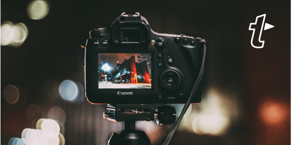 DSLR camera taking photo of a city