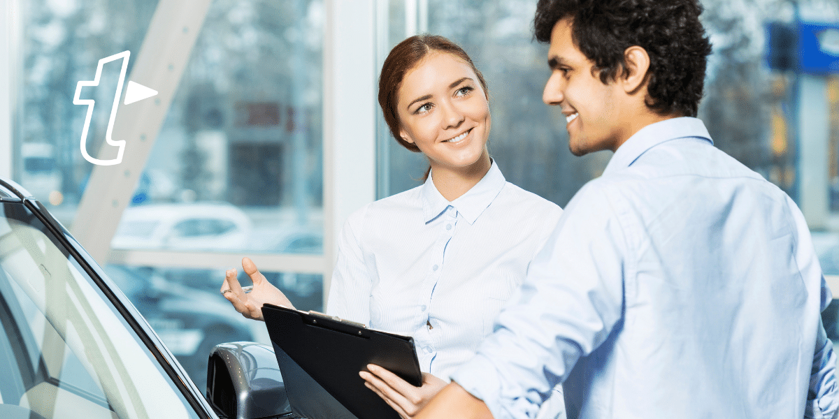 car salesperson chatting to customer