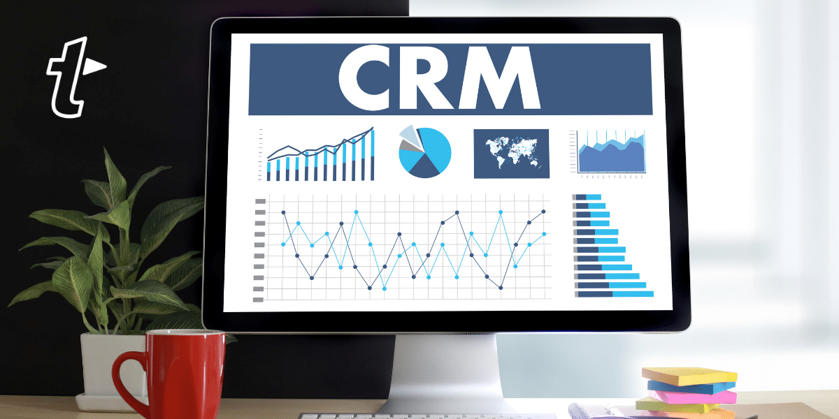 a desktop computer showing graphs and 'CRM'