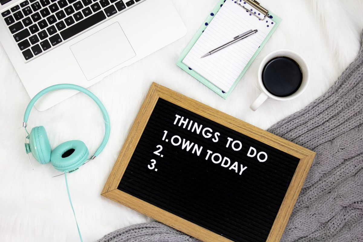 a desk with a to-do list that says 'own today'
