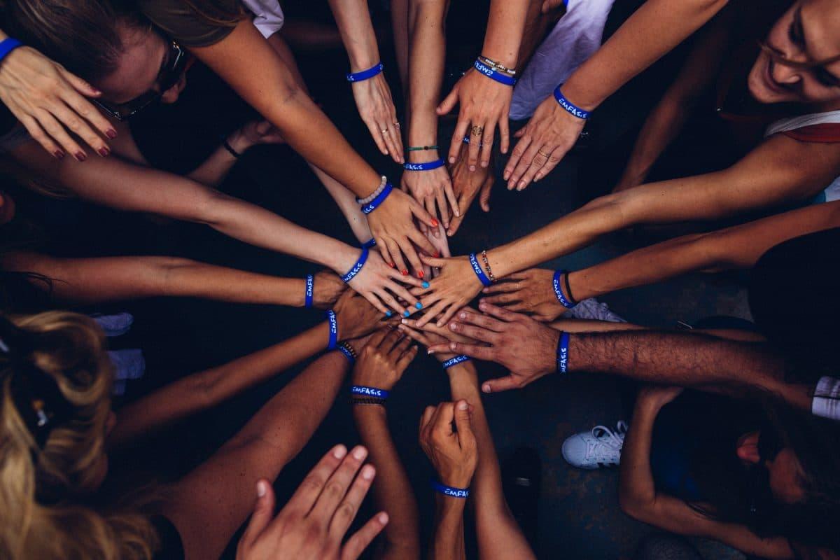 team hands together