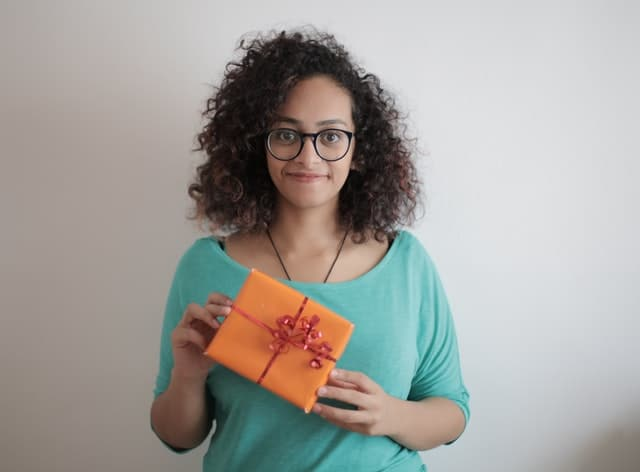 Female recruiter holding a gift.