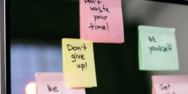 Post-it notes with motivational messages stuck on a wall