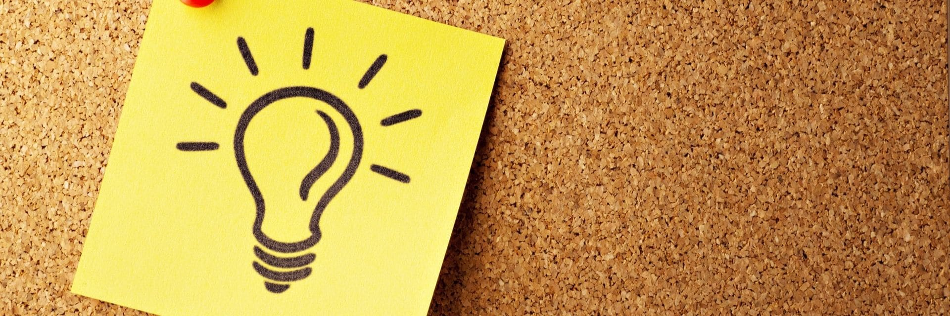 Post-it note with light bulb drawn on it, representing a recruitment idea
