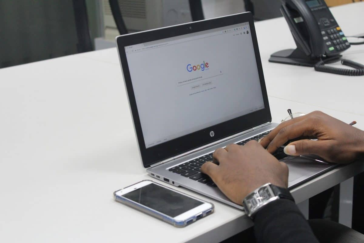 Man searches on Google, applying recruitment idea 8 of sourcing candidates.