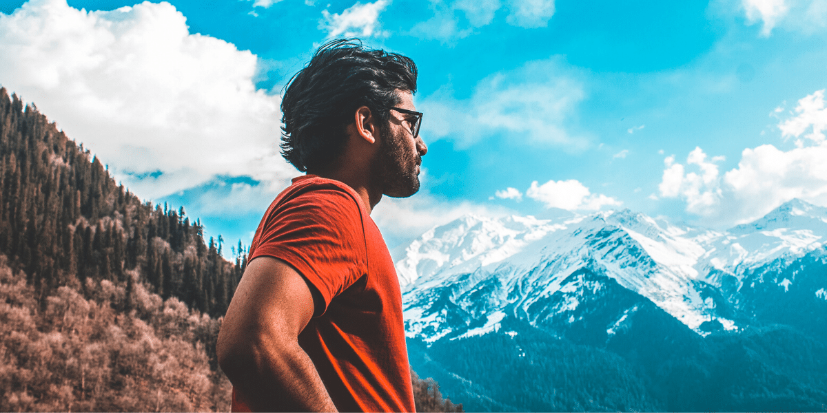 Man standing looking at beautiful mountain view