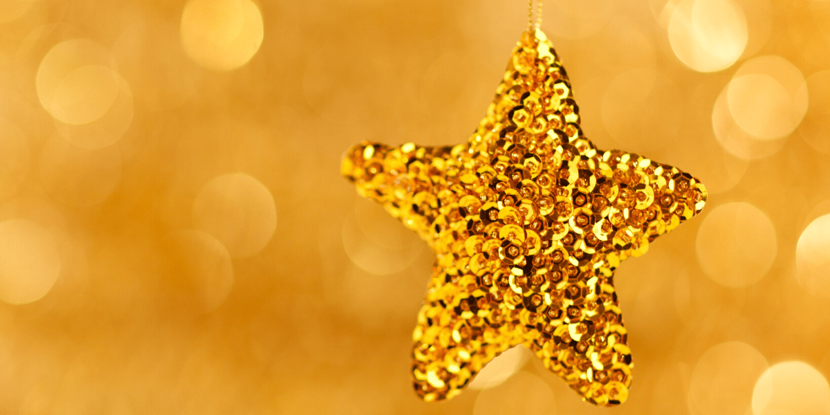 gold star with blurry background