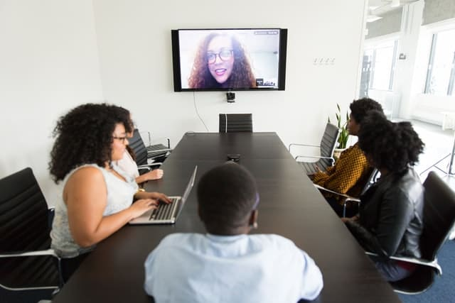 Onboarding remote employee talks with the team by videocall.