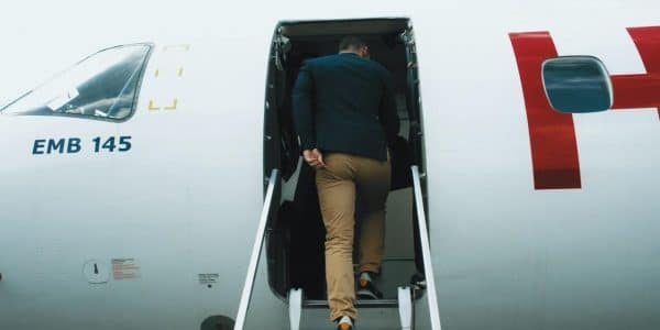 boarding a plane representing the onboarding remote employee into the team