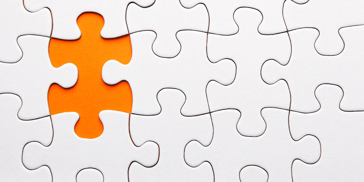 A missing puzzle piece with an orange background