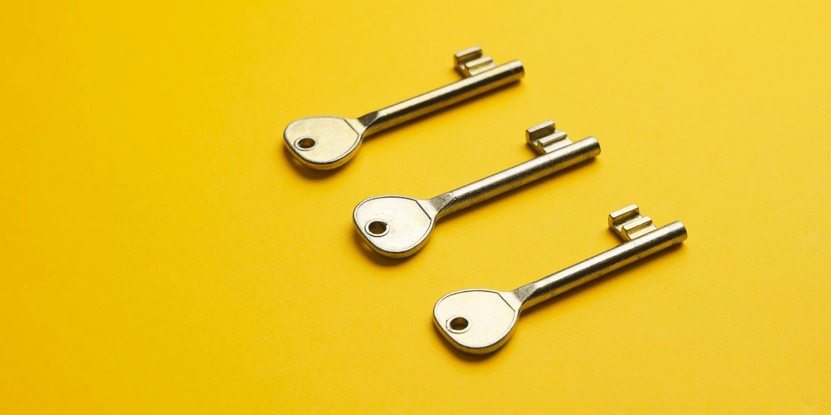 three keys on a yellow background