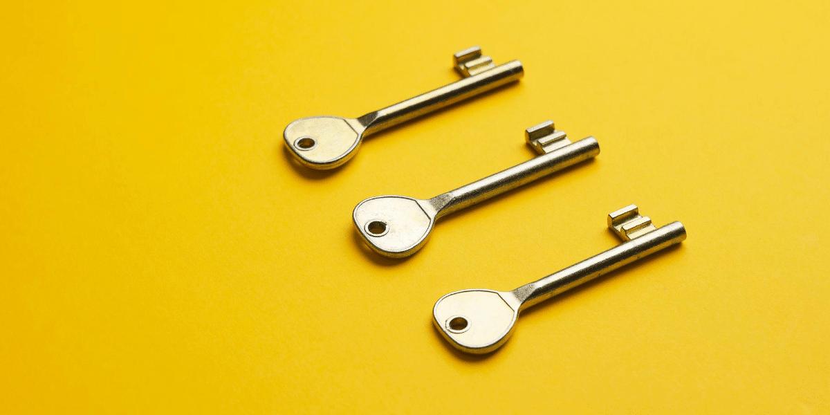 three keys on a yellow background