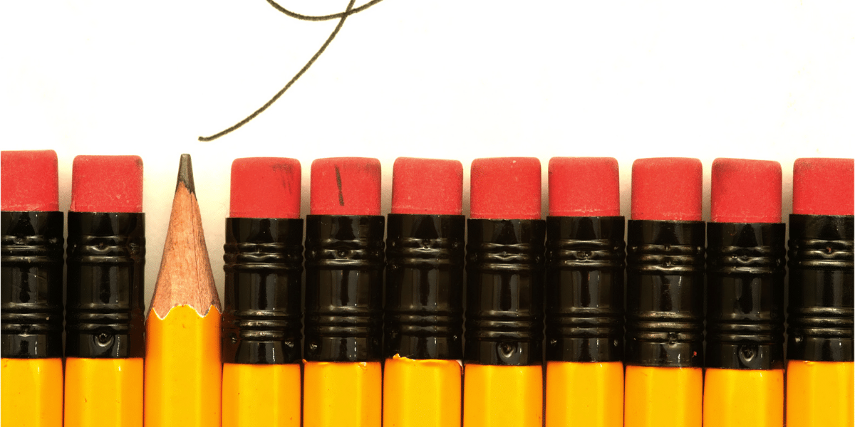 a row of pencils, one out of place