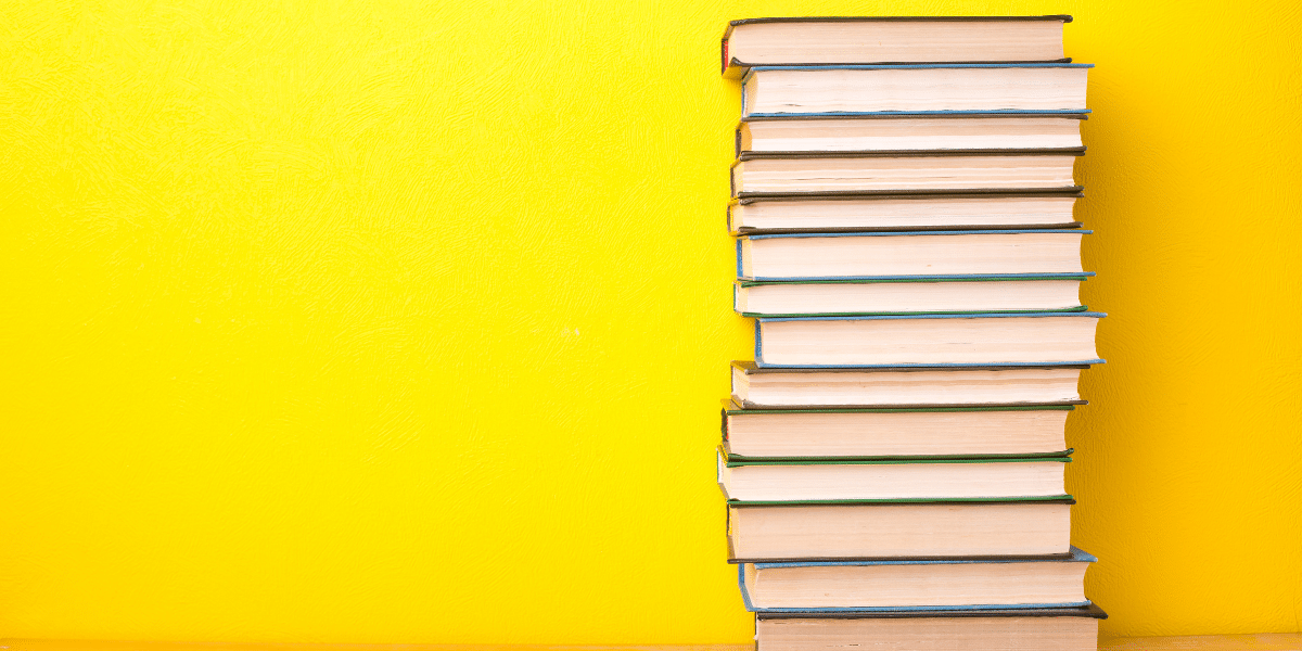 books on a yellow backrgound