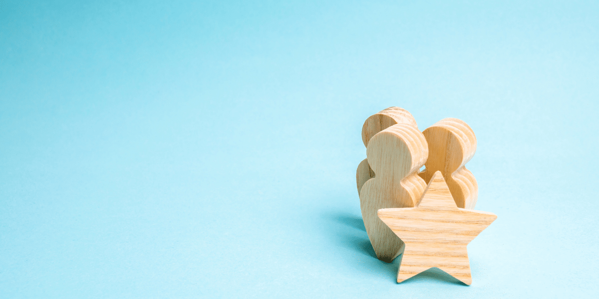 wooden figurines with a star