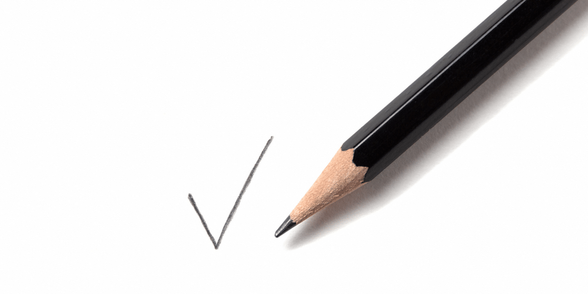 a pencil drawing a checkmark