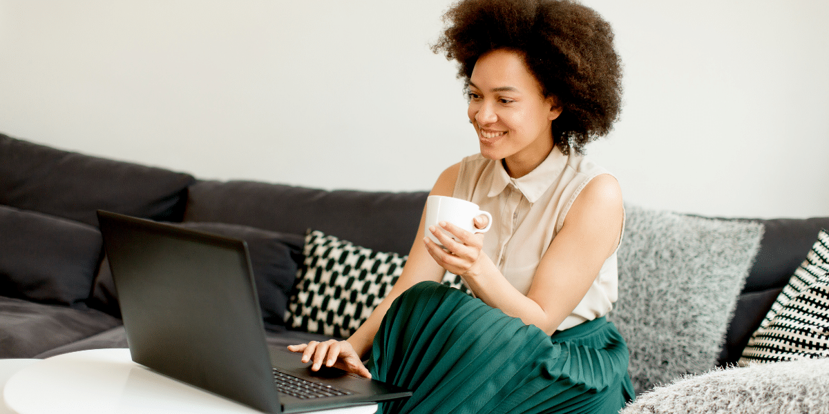 woman smiling drinking from a mug