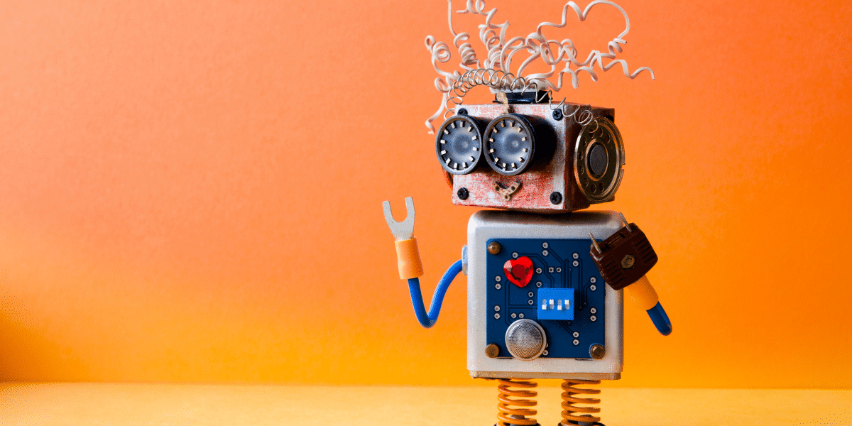 cute robot on orange background