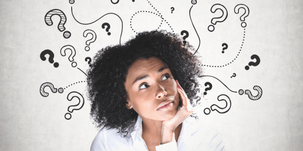 woman thinking with question marks around her