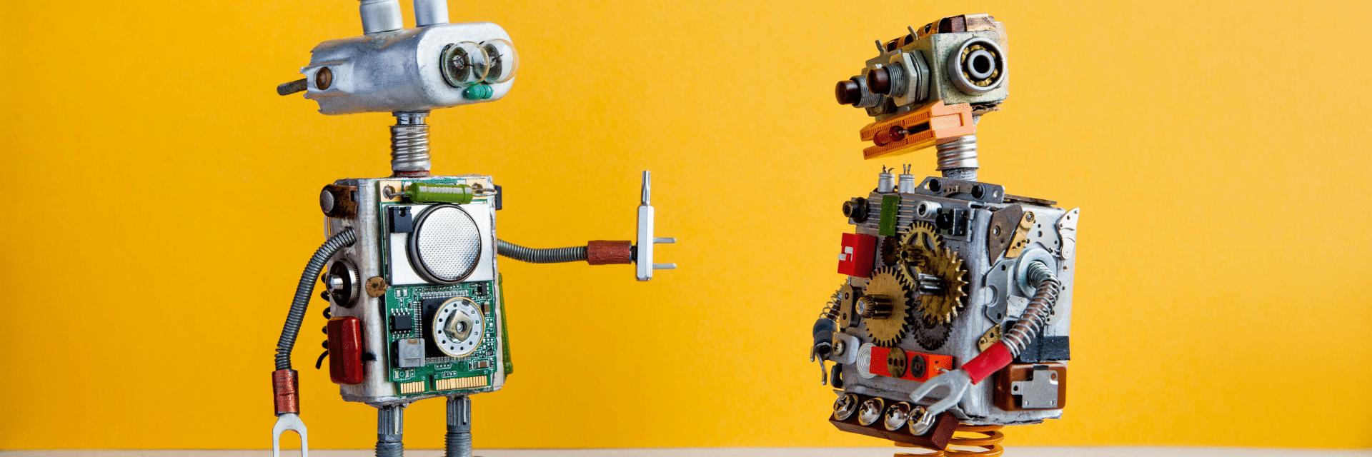 a robot passing another robot a tool