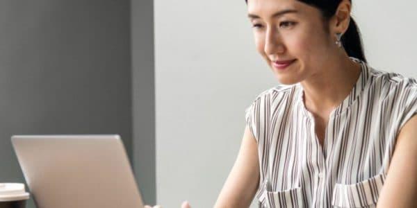 Recruiter searching blogs on laptop