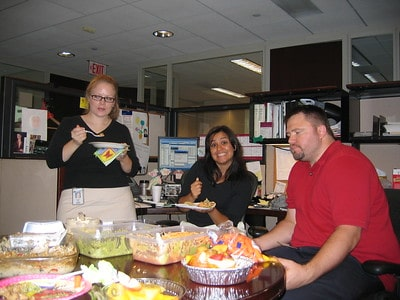 Employees eating at a thanksgiving potluck