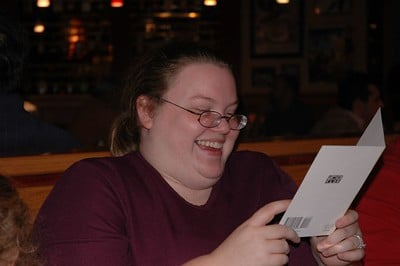 Employee reading a thank you card at work