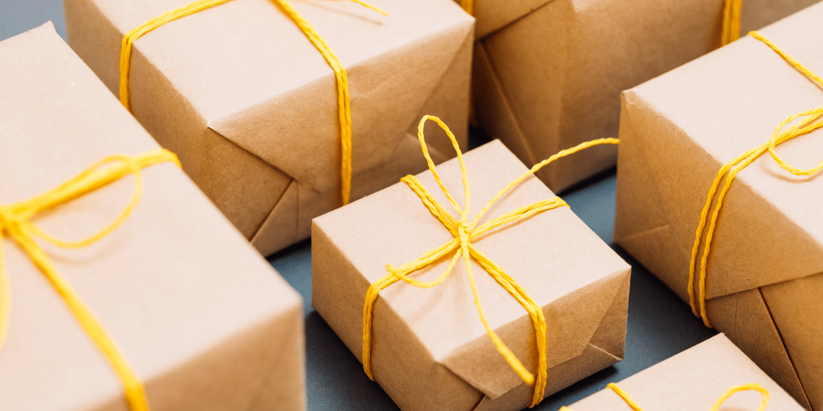 packages gift wrapped with yellow string