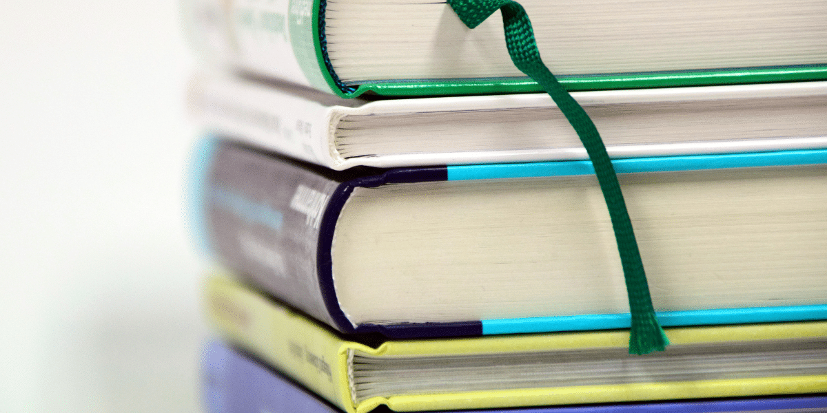 a stack of large research books