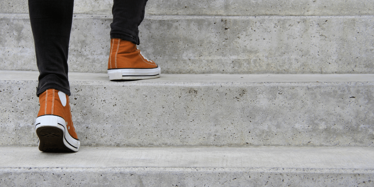 close up of shoes walking up steps