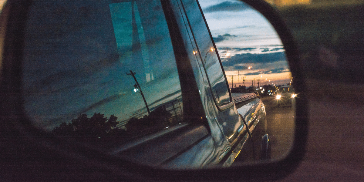 car mirror with city reflection