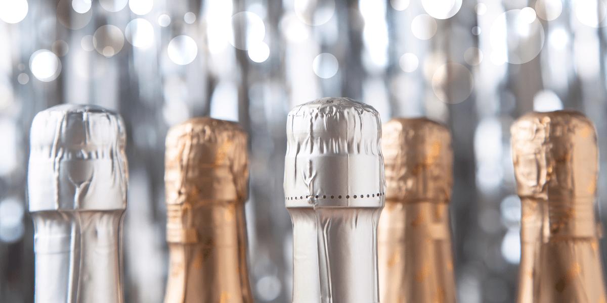 tops of champagne bottles