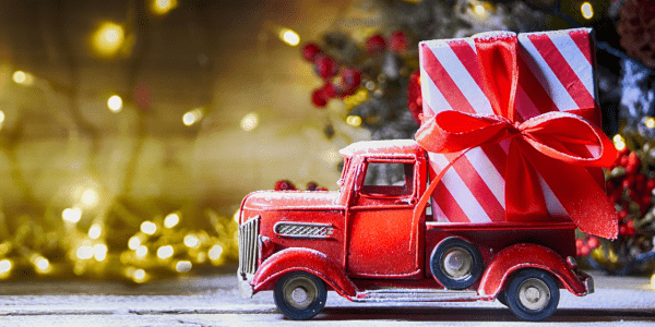 Toy Christmas truck carrying a large gift