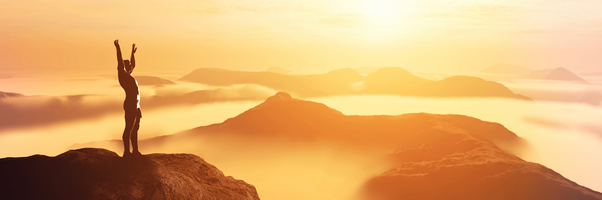 person on top of mountain at sunset