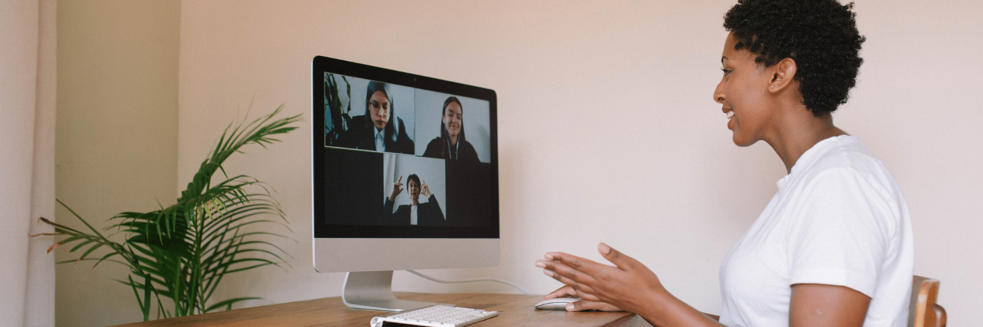 female sat at desk in remote meeting