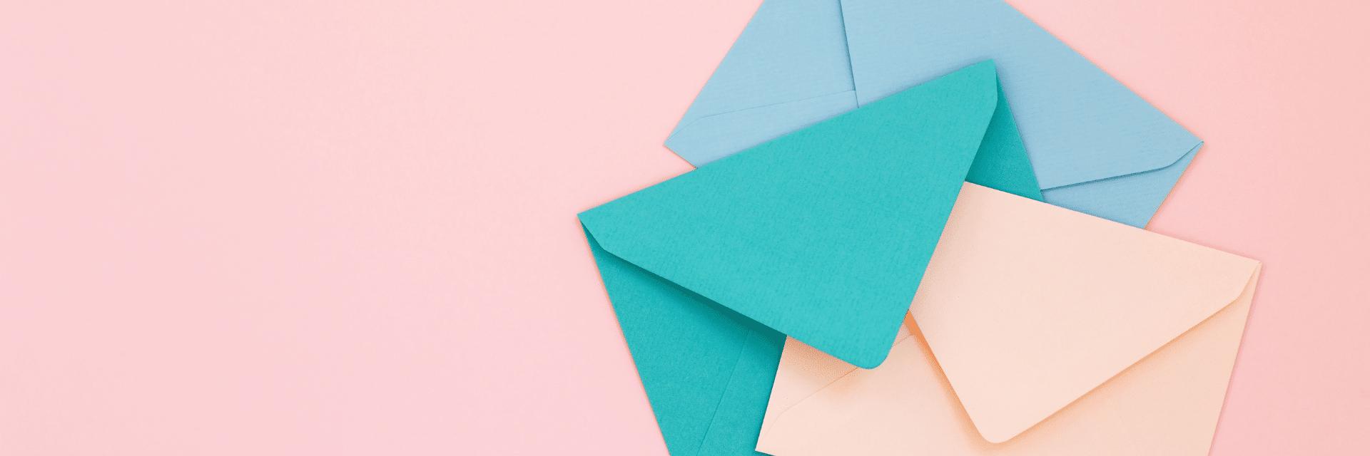 3 envelopes on pink background
