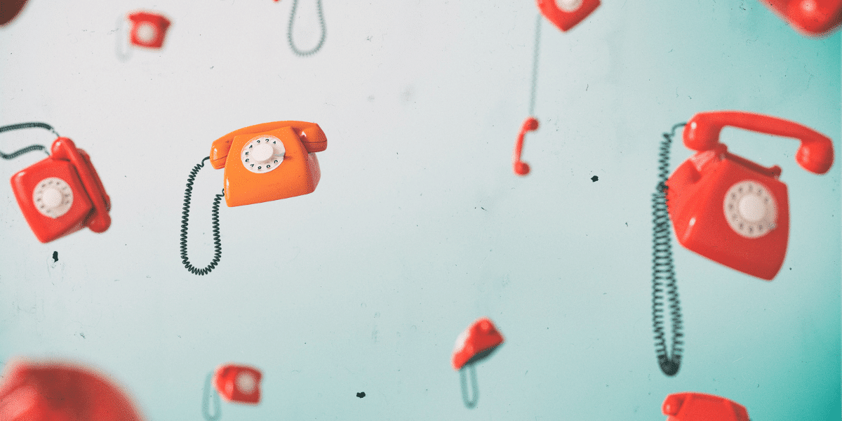 red telephones on a blue background