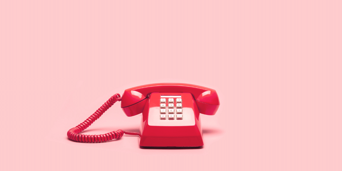 red telephone on pink background
