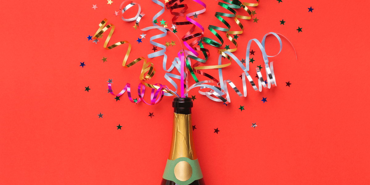 champagne bottle with confetti shooting out