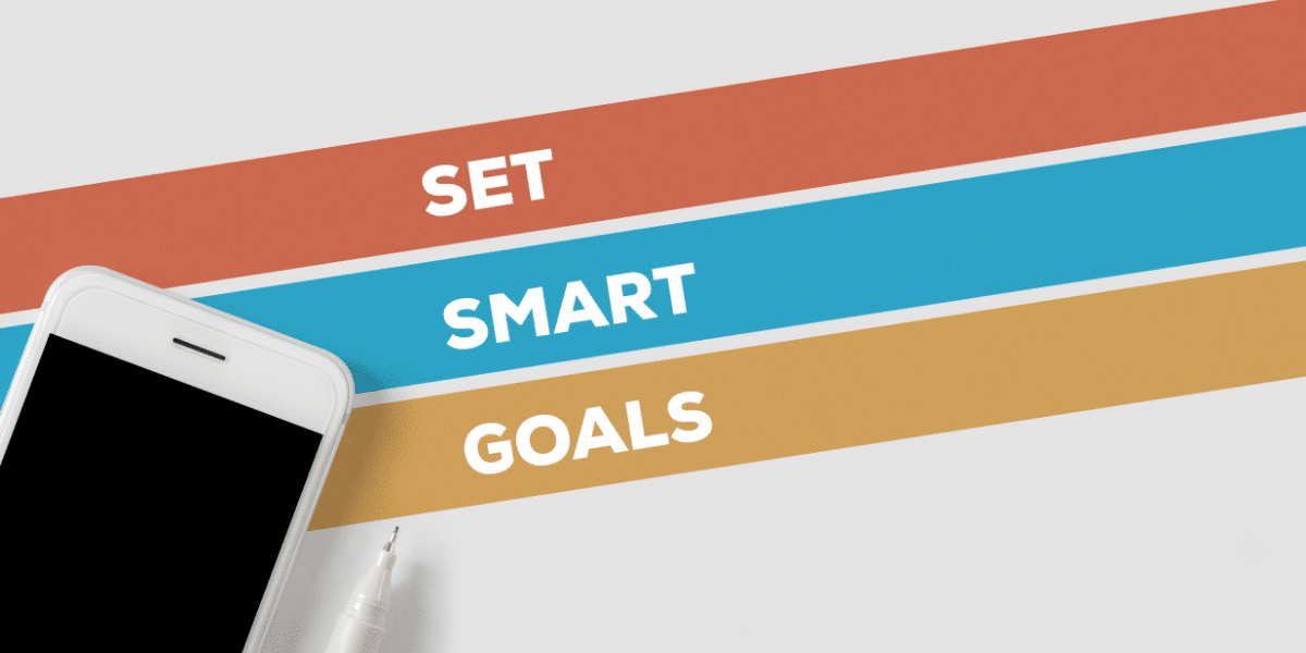 """phone on white background that reads """"set SMART goals"""""""