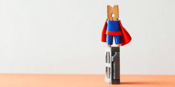 small peg wearing a super hero costume