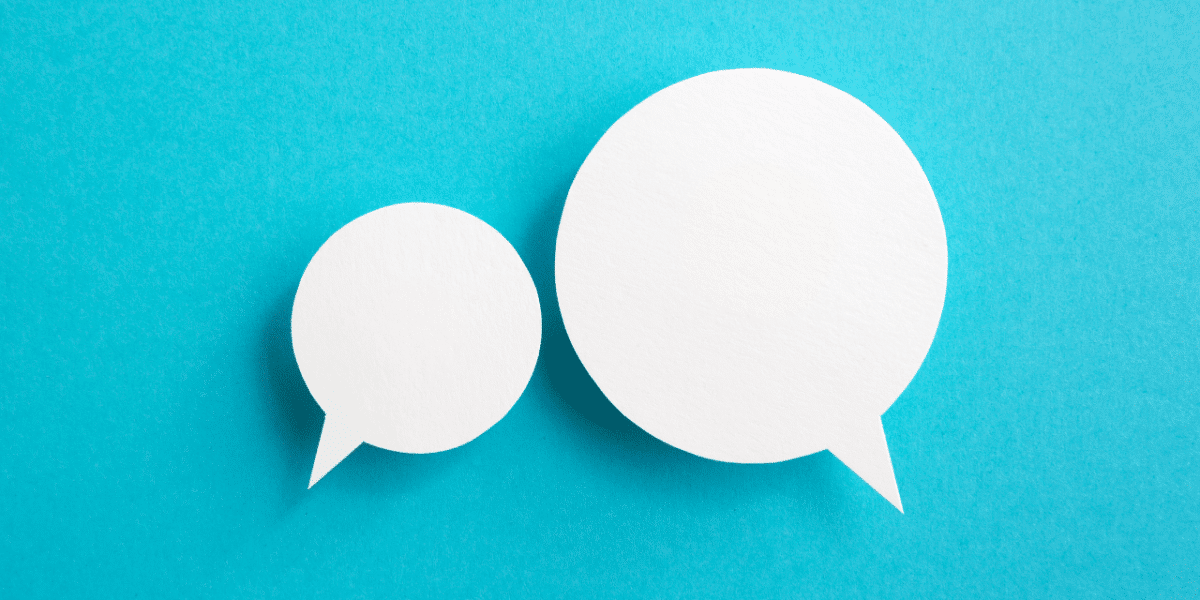 Two white speech bubbles on a bright blue background