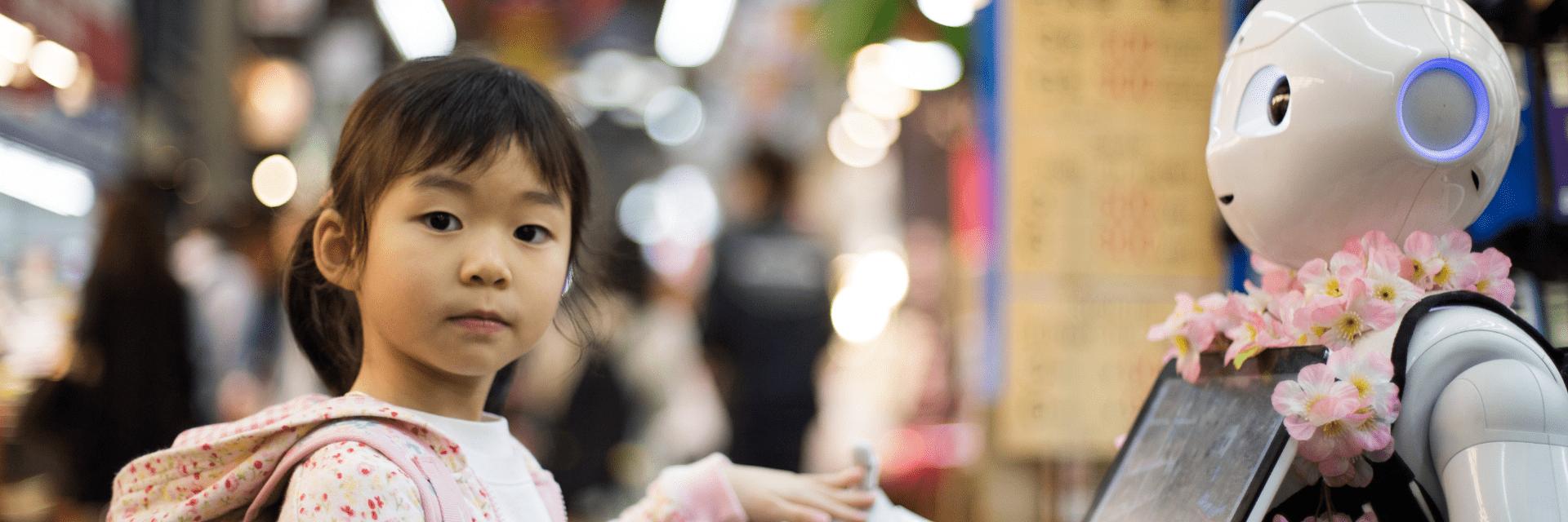 Little girl touches robot