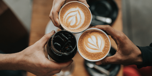 Two cappuccinos and one cold brew together symbolizing belonging in the workplace