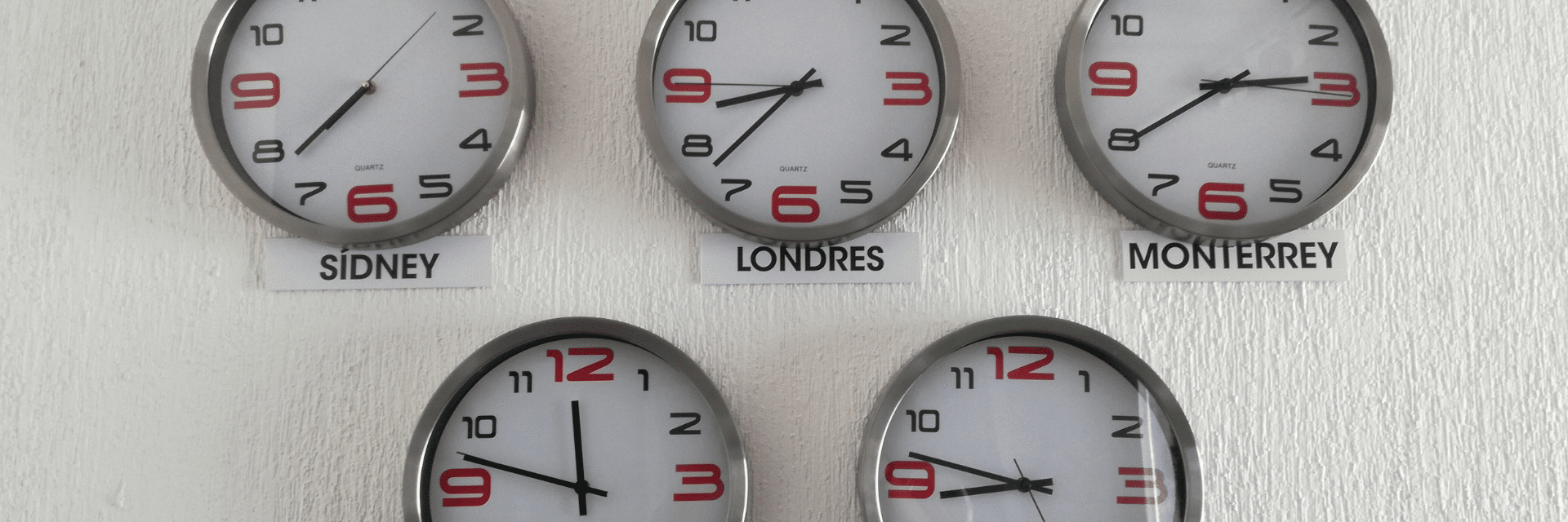 Clocks on the wall show time in different cities