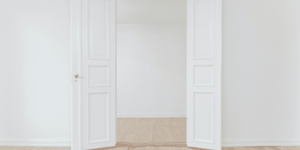 Two white doors wide open representing access to the workplace