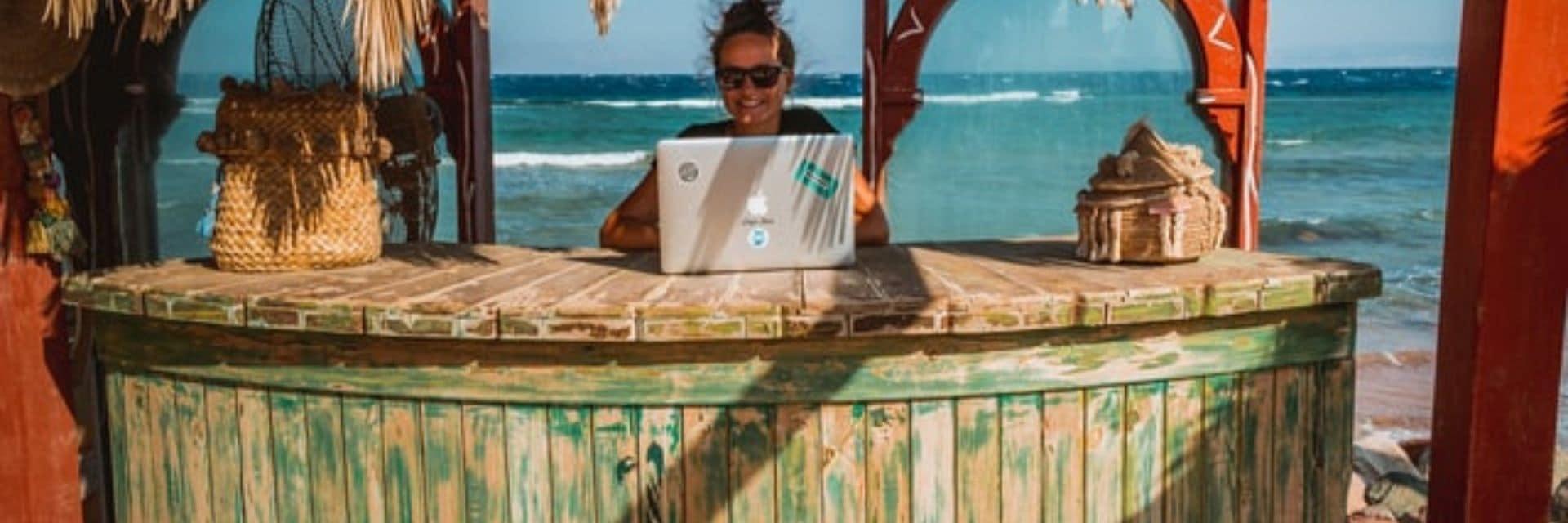 Digital nomad working in beach kiosk