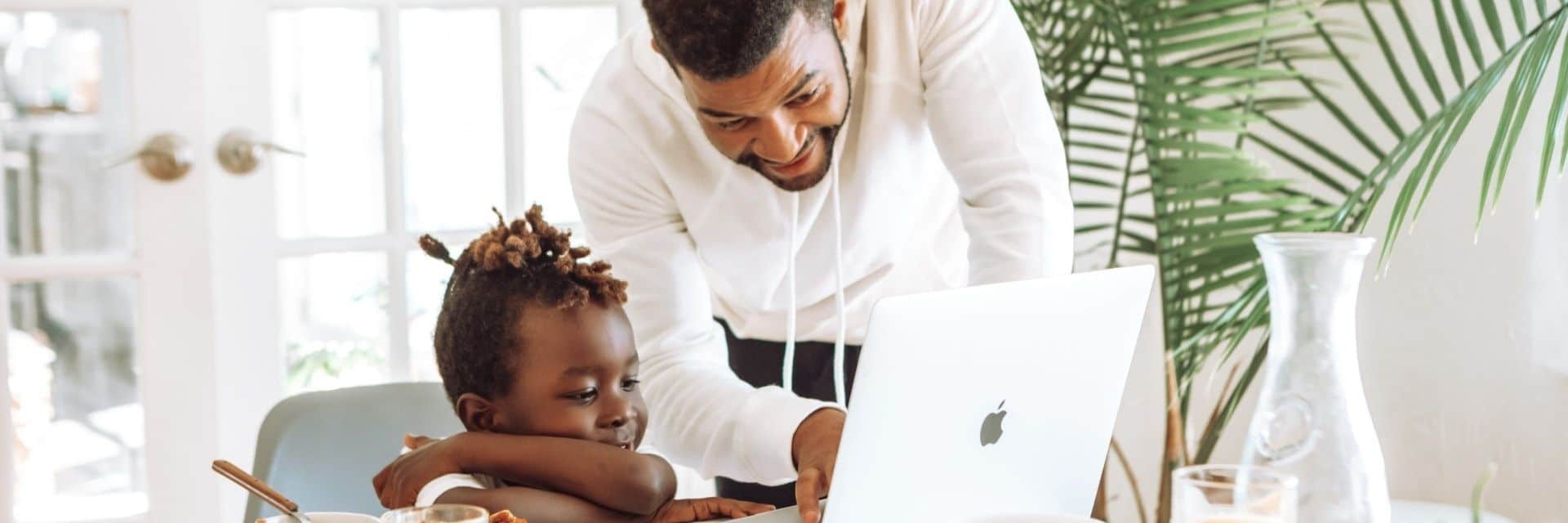 Working parents need to balance parenting and remote work, as shown in this photo of a father and his child